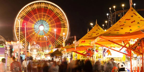 Ferris wheel and other carnival activities at the festival.