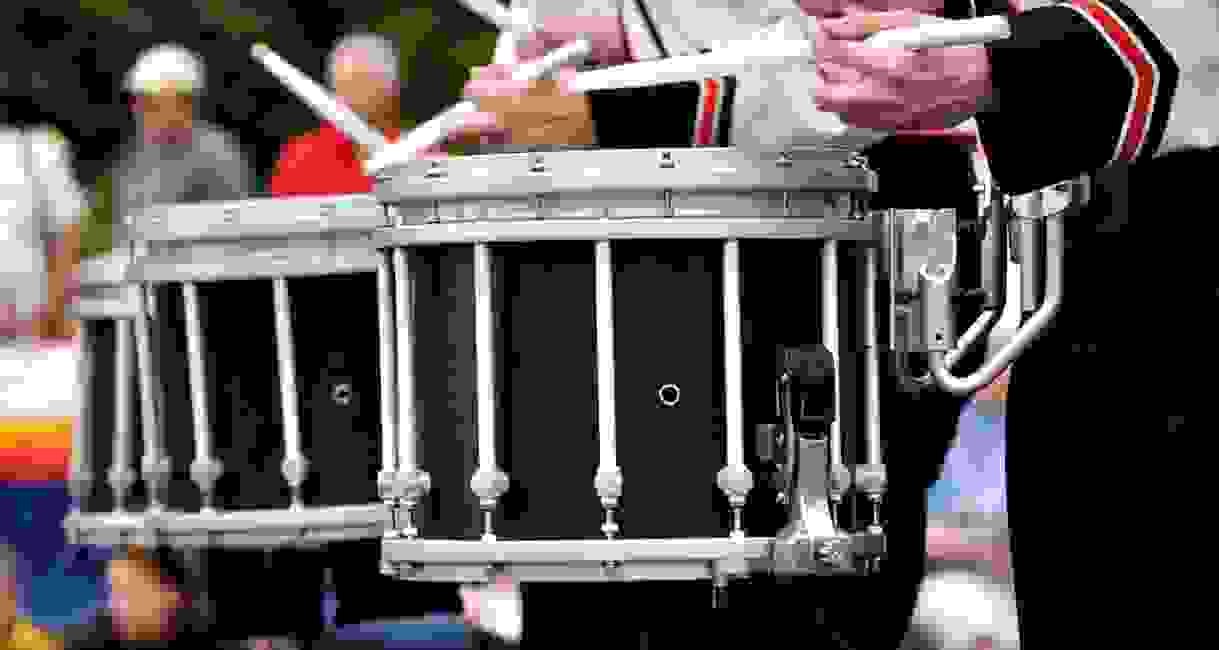 Close-up photo of a drum line in a parade.