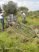 Restoration:  Beer Barrel Wagon being unearthed, before restoration