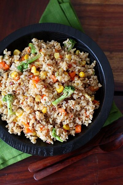 Here's a healthy alternative to fat-filled fried rice:  INGREDIENTS 1 packet Frozen brown rice  Ol