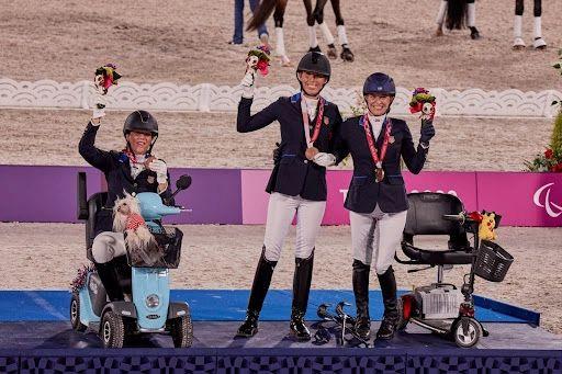 Roxanne Trunnell, Kate Shoemaker, Rebecca Hart standing for Bronze (CREDIT: FEI/LIZ GREGG)