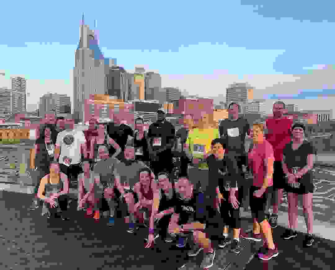 Nashville group running tour on Pedestrian Bridge
