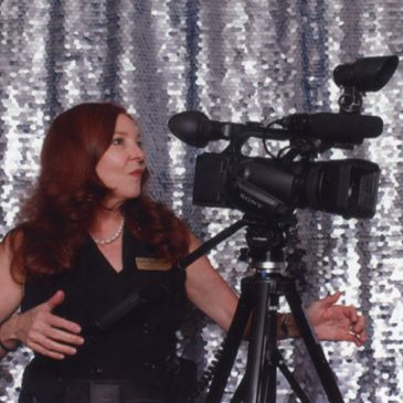 Leslie Harris-Senac shoots video footage and photos for special occasion and business convention