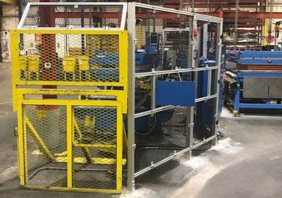 Hybrid guarding using modular T-Slotted Aluminum Extrusion machine guarding and steel fencing