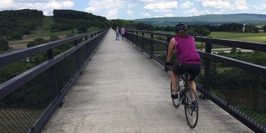 Cyclist riding across the Salisbury Viaduct on the Great Allegheny Passage