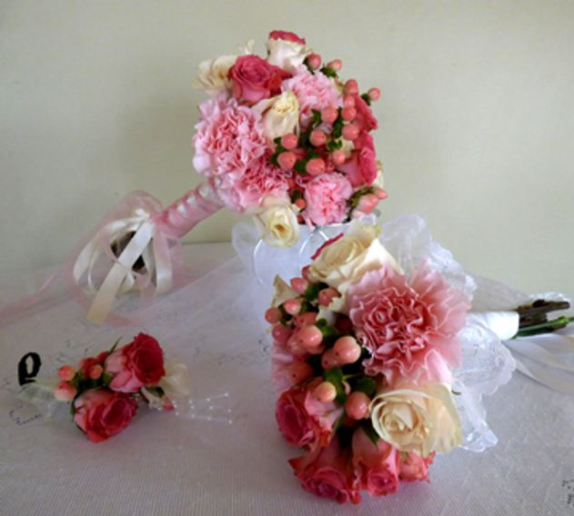 beautiful wedding flowers, bride's bouquet, boutonniere and bride's throw bouquet.