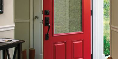 Red 3/4 clear lite steel entry door with double bore Oil Rubbed Bronze handle set and deadbolt.
