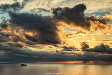 A cloudy Sunset over Filfla - Copyright Landscapes of Malta by Derren Vella