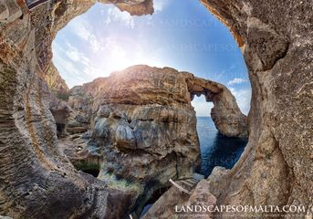 Wied il-Mielah Natural limetone arch. Panoramic views of Malta and Gozo