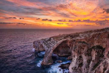 Fiery sunset over blue grotto natural arch - fine art landscapes of zurrieq by Derren Vella