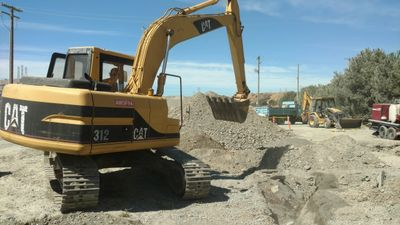 Excavator removing an old septic tank in Sunol, California. We have the contractors license for it.