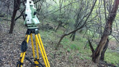 Robotic total station being used for septic topo map preparation in Fremont, California.