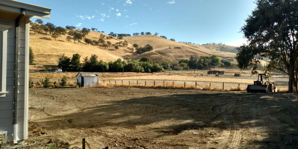 A recently installed leach field in Clayton, CA. Notice the new house and recent leach field.