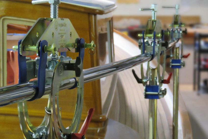 Image of three Angle-Rite Clamps holding intersecting stainless tubes to show sailboat railing setup