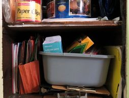 coloring and office supplies in an open cupboard