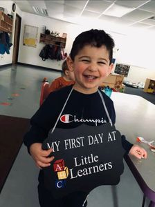 preschool child smiling on his first day