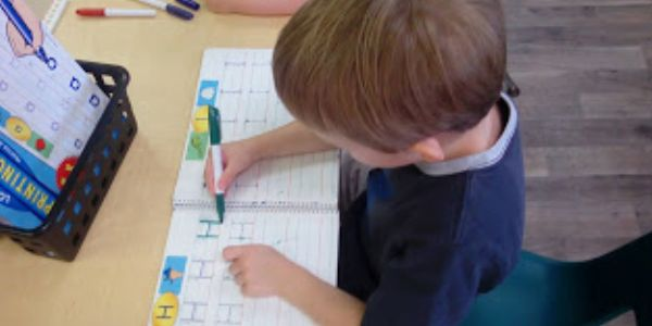 pre-k child writing