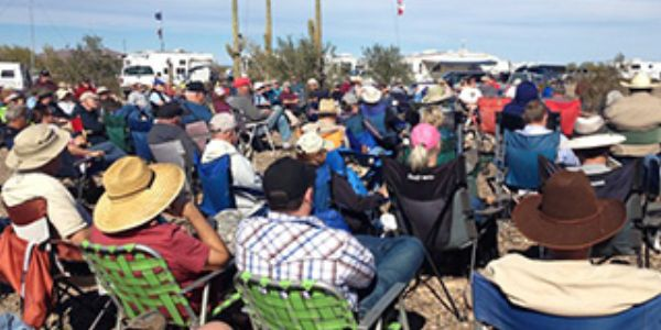 Quartzfest attendees gather at the campfire for the 1600 social hour and more presentations