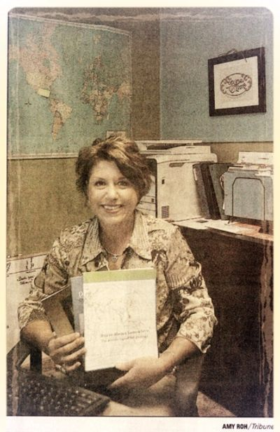 Amy Peirce is pictured in her home office. Photo courtesy Hastings Tribune.