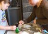 Molly and Jessie prepare the dye for bookmarks - Ag Day March 2019