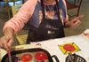Karen applies melted crayon to silk screened design-Fall Fiber Arts Day 2018