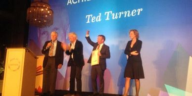Ted Turner and Sir Richard Branson with Kartonart cardboard lectern in Paris.