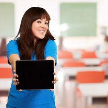 Confident girl showing her iPad to others.