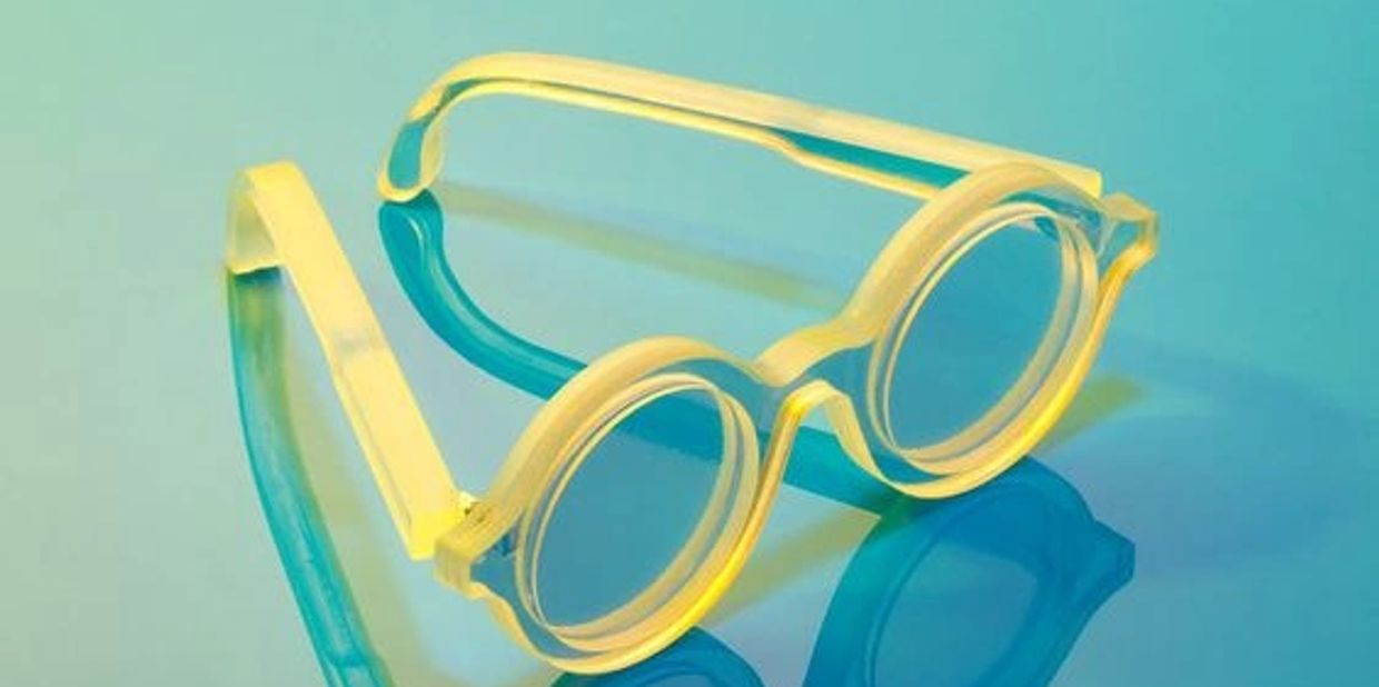 Round Yellow Eyeglasses in a blue shade background