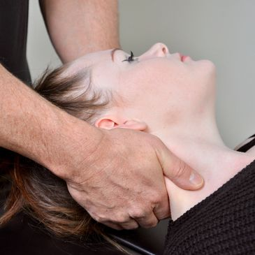Demonstration of cervical manipulation hand placement