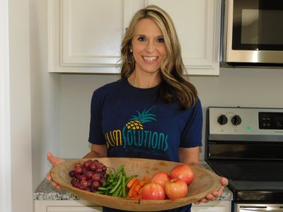 Julie shows a beautiful assortment of healthy fruits and vegetables.