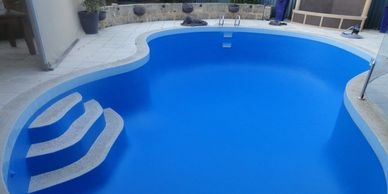 Concrete swimming pool or fibreglass pools using special pool paint and dehydrating the concrete.