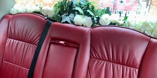 Burgundy leather seats in London Taxi Wedding Car