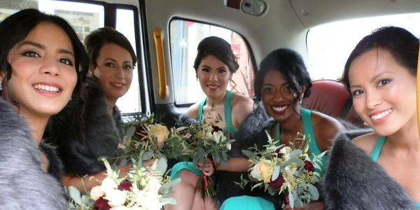 Five Bridesmaids in rear of London Taxi Wedding Car