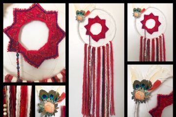 Fourteen inch dream catcher. White yarn wraps the ring and a star woven into the center.  A fall of