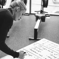 Trainer at Shed Fitness Columbus writing a circuit-style workout