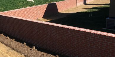 brick fence construction by hardscape contractor