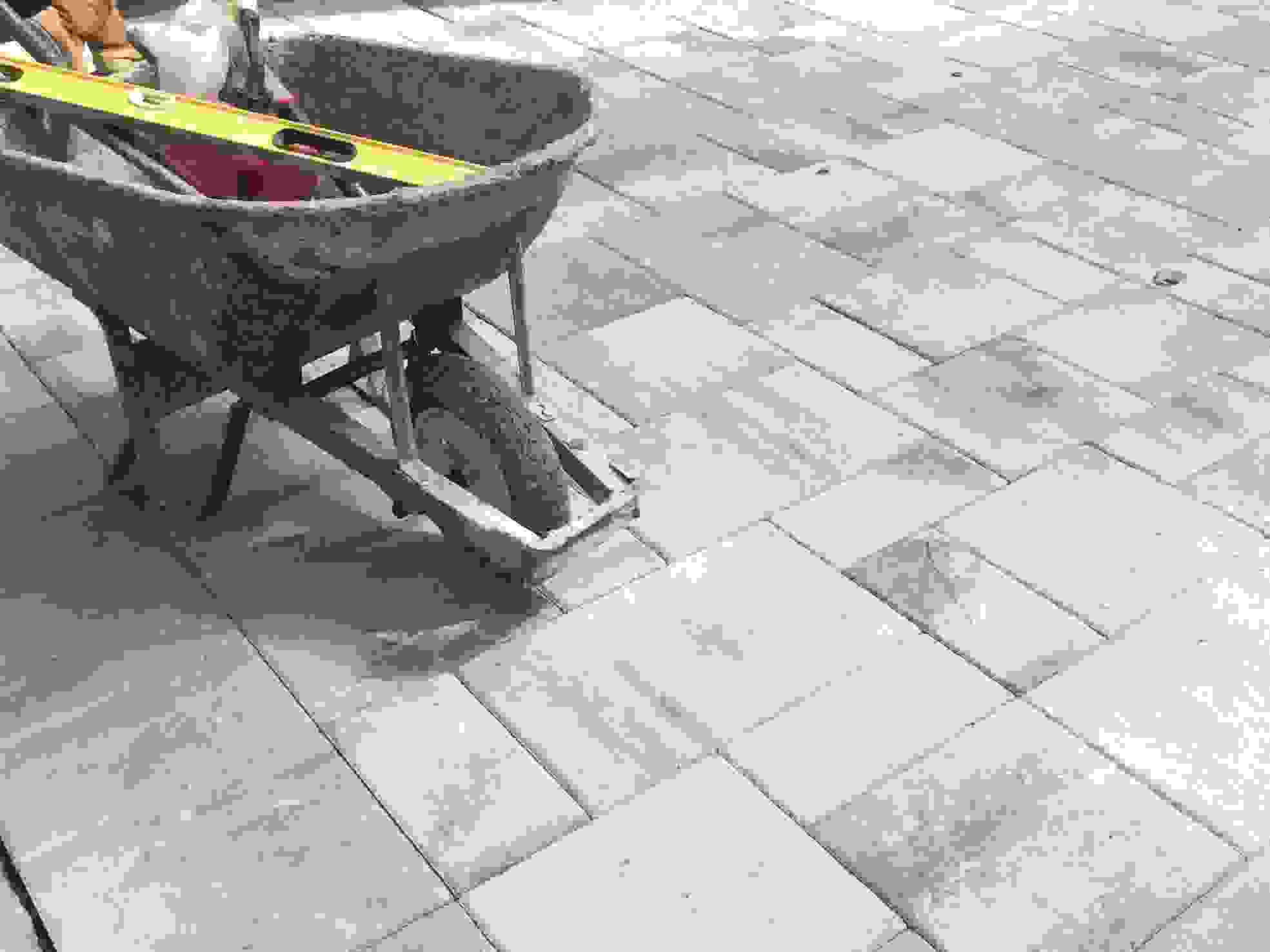 Concrete patio construction with wheelbarrow level and other concrete contractor tools