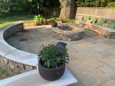 a completed stone bench, fire pit, and patio