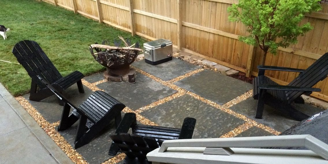 backyard patio project with crushed rock and fire pit