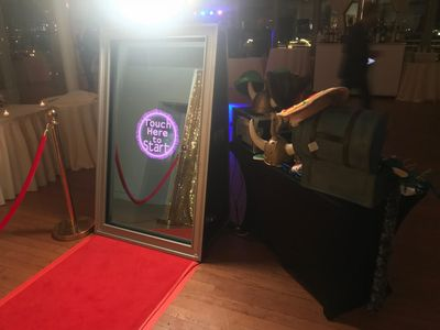 The Mirror Me selfie photo booth with custom templates and red carpet experience.  Open air photo