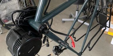 bafang motor being installed in a bike frame