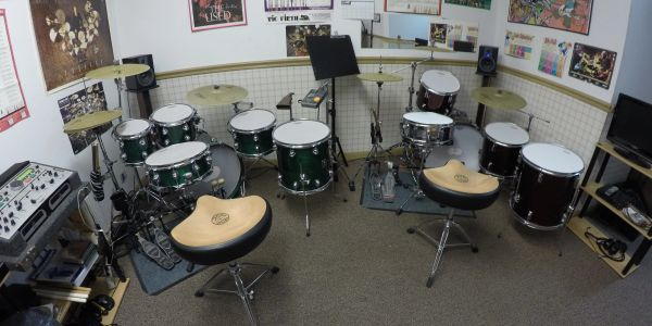 Drum kit room featuring two kits outfitted with Remo silent stoke heads and Zildjian L80 cymbals