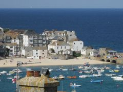 St Ives is known for its surf beaches, like Porthmeor, and its art scene. The seafront Tate St Ives