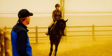 Pete Knox DVM, DACVS watches a horse under saddle to help diagnose its lameness