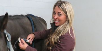 Kate Robbins administers IV medications to a horse at Idaho Equine Hospital