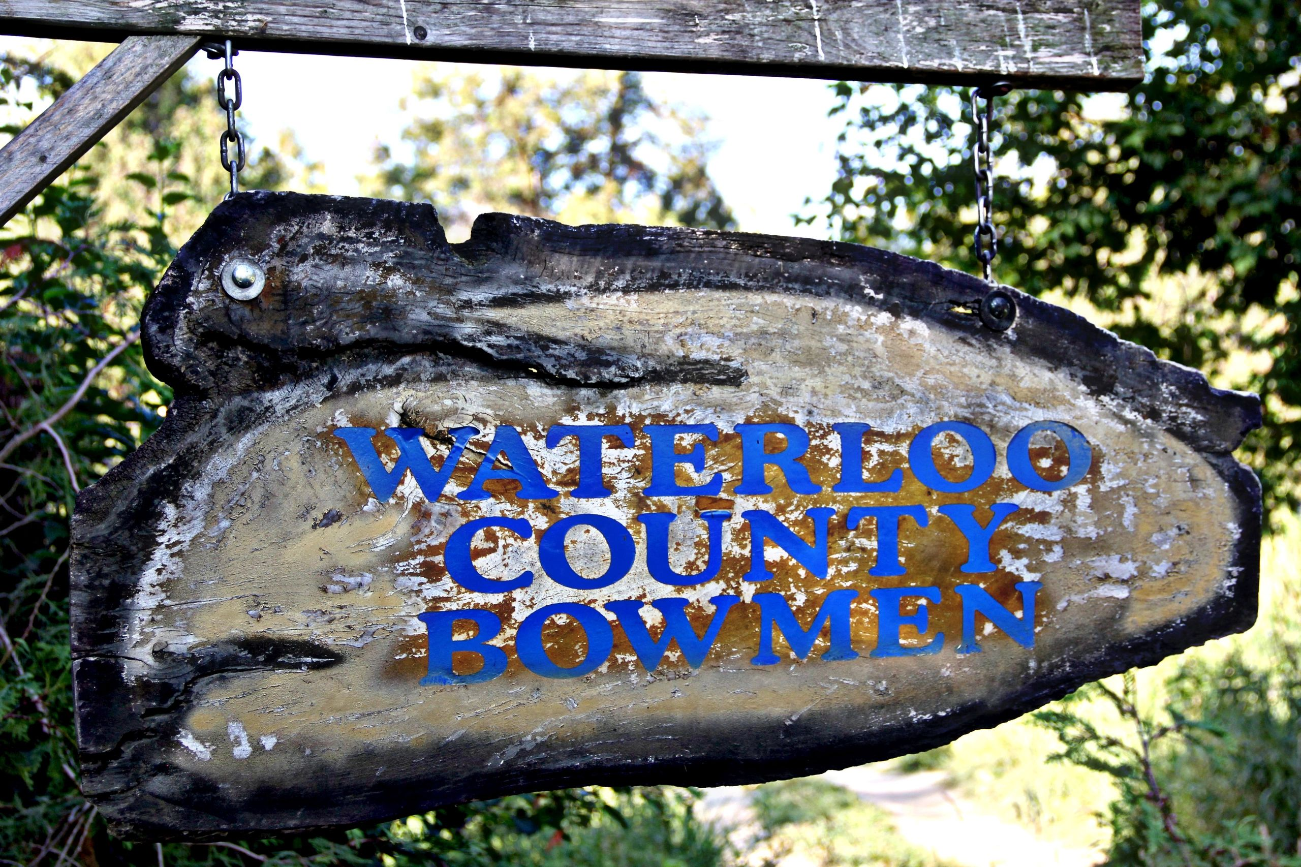 Waterloo County Bowman's wooden sign with title in blue.