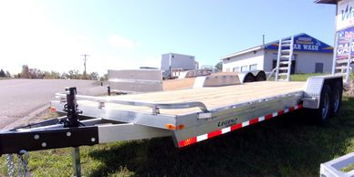 These equipment haulers can tow everything from a small car to full size trucks and tractors.