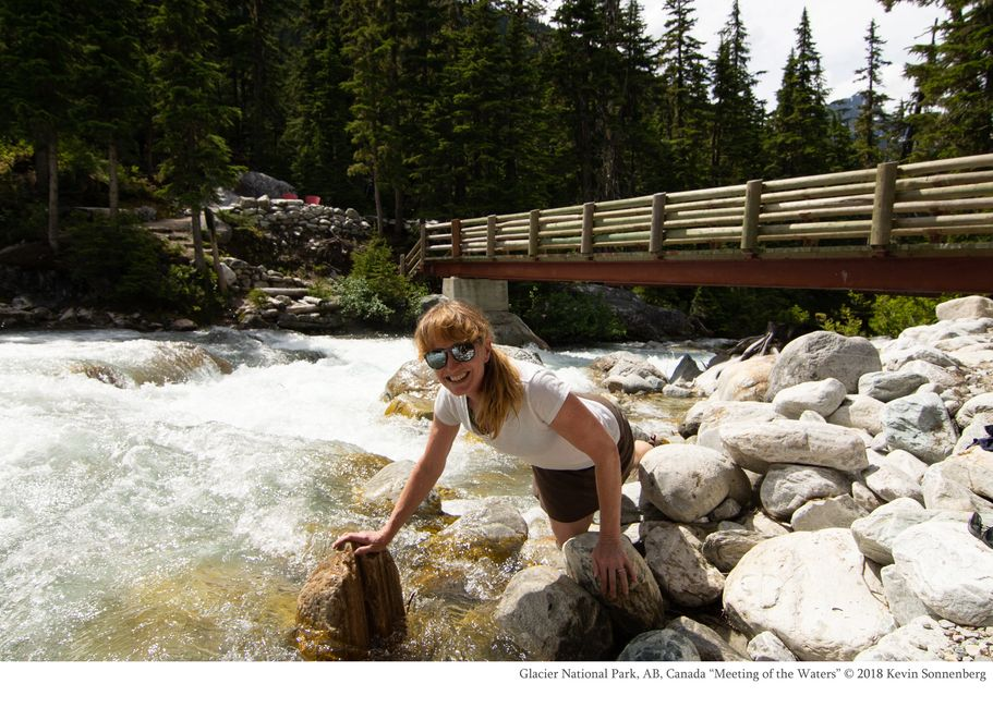 Glacier National Park, AB, Canada Sheryl Sonnenberg looking up after drinking from Glacier water