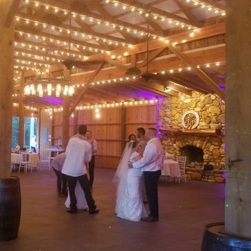 A bride and groom dance up at the Bull Mountain Lodge