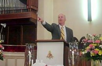 Pastor Scott in the pulpit